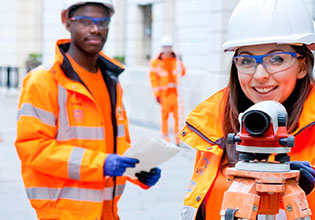 Two employees wearing high visibility jackets