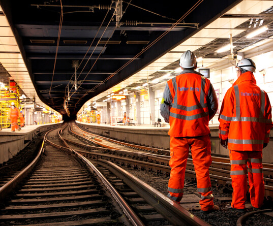 Two workers in rail tunnel