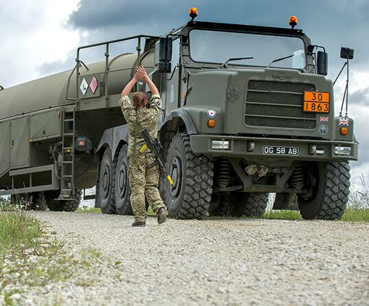 Female soldier with supply truck