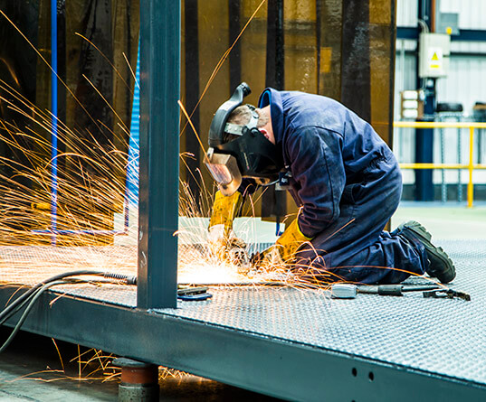 Welder working in a safe environment