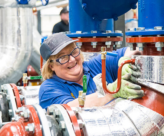 Lady working on a pipework module