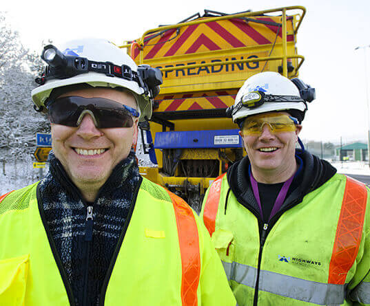Workers in front of gritter