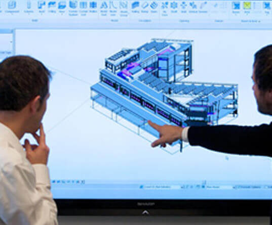 Workers reviewing BIM model