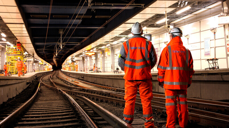 Rail workers on the tracks in a closed sub-surface station