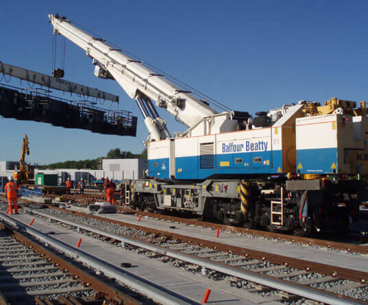 a rail mounted heavy lifting crane lifting in a gantry