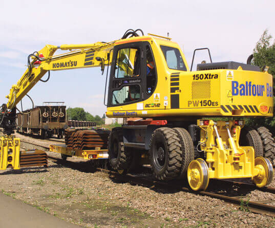 a road rail vehicle lifting some sleepers
