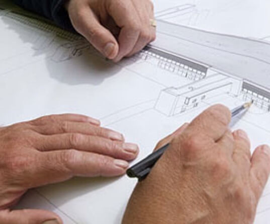 People working on a building plan