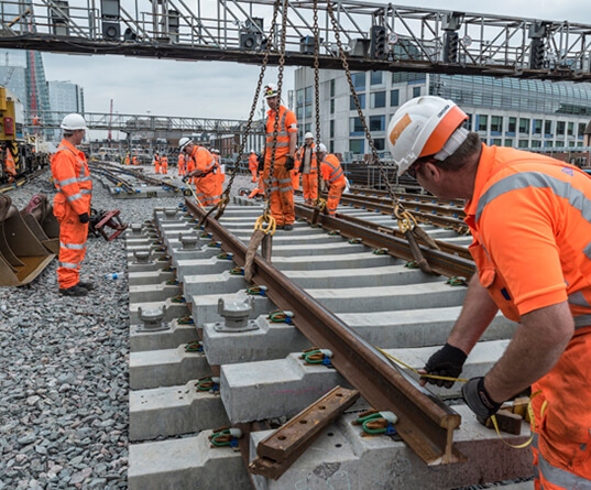 Rail workers installing new track