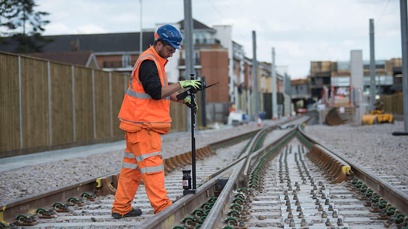 Person inspecting rail track