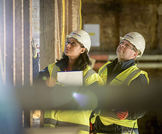 Male and female engineer on site